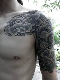 picture of black and white cloud tattoo on the shoulder and bicep