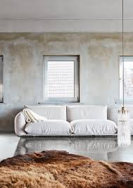 No Sofa Living Room Distressed Walls And Ivory Sofa And Faux Fur Rug Inspiring