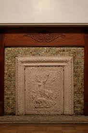 fireplace covers a pink brownstone in brooklyn