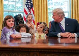 washington trump greets kids in oval office for early halloween