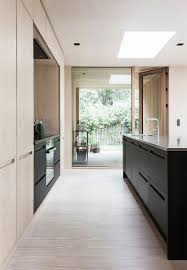 black modern kitchens the cool black and light wood carpenter kitchen has discrete built
