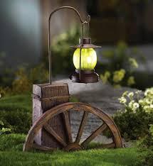 garden solar decorations 1000 ideas about wagon wheel light on