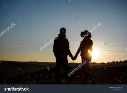 lovers dawn sunset stock photo 652330354 shutterstock