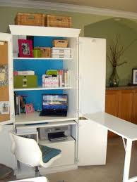 craft cabinet with fold out table betterafter net fold out ironing board in place of that add on desk