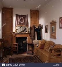 antique pine settle in small living room with mirror above pine