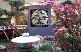 small space japanese garden with natural green plants and japanese
