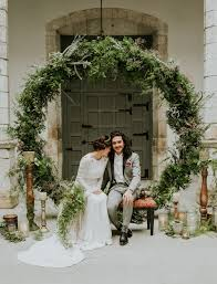 wedding backdrop greenery 70s inspired elopement filled with greenery greenery
