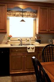 How To Make Old Wood Cabinets Look New Updating Our Kitchen Cabinets With New Mouldings The Creek Line