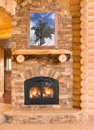 log cabin home interior with warm fireplace with wood flames