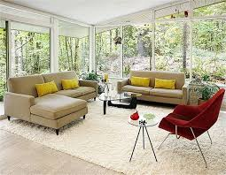 furniture white furry rug with brown sofa and red chair plus