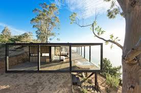 landscape house coastal house on bluff designed to blend into landscape