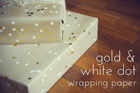 the pink doormat gold and white dot wrapping paper