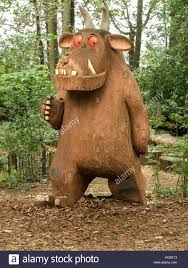 large wood carvings large gruffalo wood carving sculpture in woods at westonbirt stock