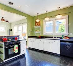 images of white kitchen cabinets with black appliances kitchen room with green walls white cabinets and black appliances