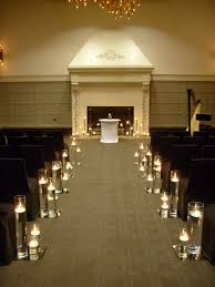 aisle markers altar arch arrangements city indoor ceremony wedding