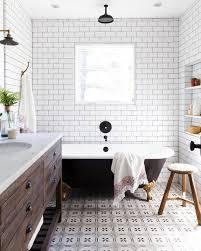 patterned tile bathroom subway tile bathroom with patterned tile floor and black clawfoot