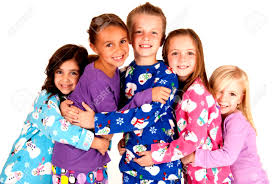 children in winter pajamas hugging each other stock photo picture
