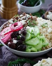 greek brown rice bowls running to the kitchen