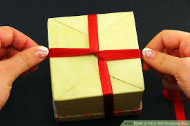 bows for presents tying bows on presents how to tie a gift wrapping bow 6 steps with