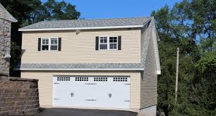 garages with apartments two story buildings storage sheds and prefab car garages full