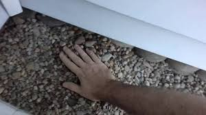 landscaping with river rock and landscape fabric how to lay stone
