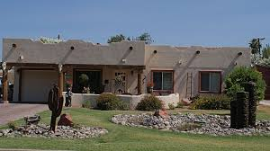 pueblo style house plans pueblo style flat roof adobe or earth colored stucco walls with