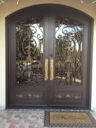 custom wrought iron door with eyebrow arch grille single doors