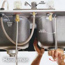 removing faucet from kitchen sink how to replace a kitchen faucet family handyman