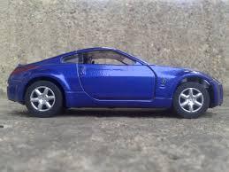 blue nissan 350z with black rims free stock photo of 350z blue blue car