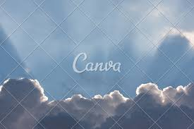 blue sky with clouds and sun rays photos by canva