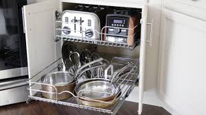 how to organize pots and pans in a cupboard how to organize your pots pans kitchen organization ideas