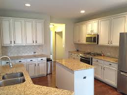 white kitchen cabinets refinishing painting kitchen cabinets before after mr painter