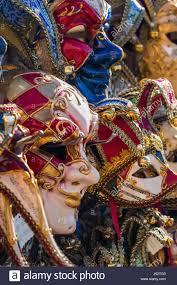 venetian masks bulk picture of a bulk of venetian masks hanging at a rack stock photo