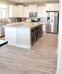 Laminate Flooring In Kitchens Kitchen Floor Stainless Steel Kitchen Appliances White Cabinets