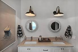 shared nautical boys bathroom with gray porthole mirrors cottage