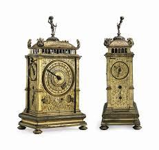 German Clocks A South German Engraved Gilt Brass Quarter Striking And