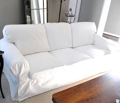 how to put slipcover on sofa can you put slipcovers on leather