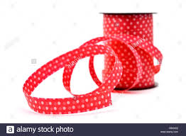 patterned ribbon a roll of ribbon patterned with white dots on a white