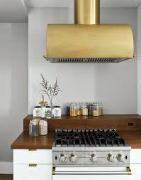 kitchen brass vent hood reviews with wood countertop also white