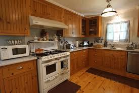 kitchen designs with oak cabinets black granite countertop