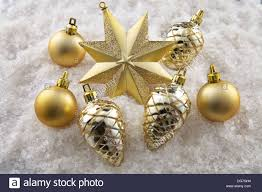 a group of christmas ornaments on a snow background with top down