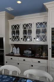 white painted hutch cabinetry with curved mullions and clear glass
