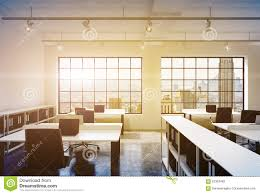 workplaces in a bright modern loft open space office tables