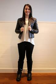 black biker booties winter knitwear black jeans neutral jumper black booties