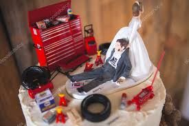 mechanic wedding cake topper or mechanic wedding cake topper stock photo