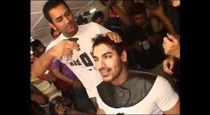 m s dhoni giving a hair cut to john abraham youtube