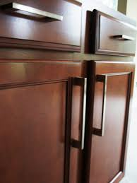 kitchen cabinet handles and a light tone wood cabinet complete