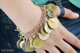 charm bracelet make images 24 repurposed foreign coin diy charm bracelet diy projects for teens jpg
