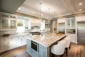 carrara marble kitchen island white kitchen with calacatta carrara marble counter and moody blue