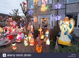 kitsch christmas decorations in suburban house garden leiston